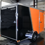 Rear view of black and orange single axle professional series trailer