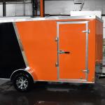 Side of orange and black trailer
