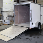 rear of small white trailer