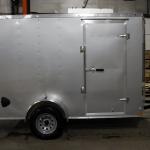 side of silver single axle trailer