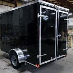 rear of black single axle trailer