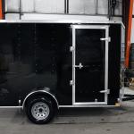 side of black single axle trailer