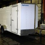 front of white light duty trailer
