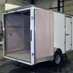 rear of white light duty trailer