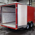 open rear of red tandem axle standard duty trailer