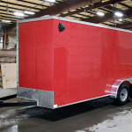 side of red tandem axle trailer