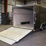 rear of grey tandem axle trailer